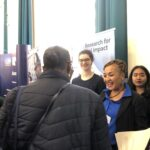 LIDC staff discussing membership with student at City UoL Law & Soc Sciences Fair, 2019